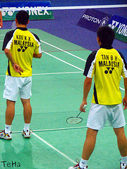 Badminton Doubles Players serving: Koo Kien Keat / Tan Boon Heong